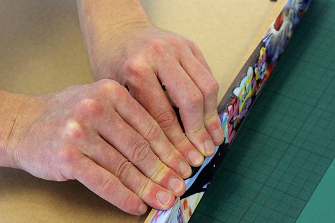 Sticking down the vinyl frame wrap