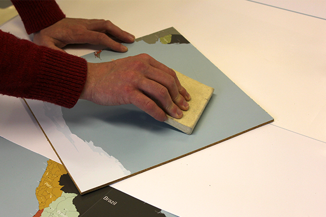 Cork map sticker application