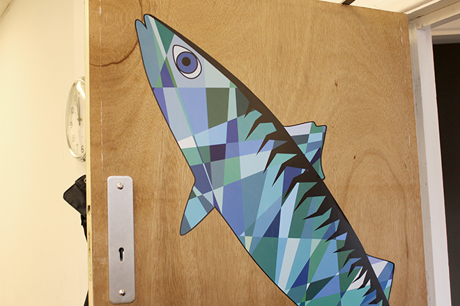 Repositionable mackerel wall sticker on door