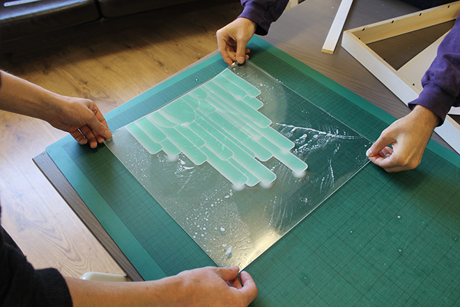 applying clear sticker to plastic