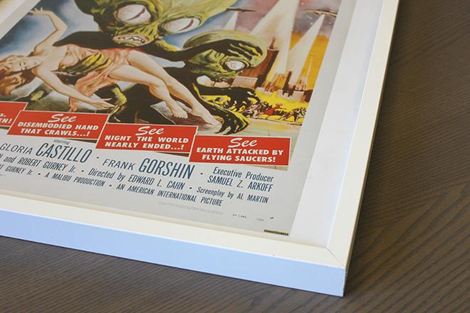 framed b-movie poster