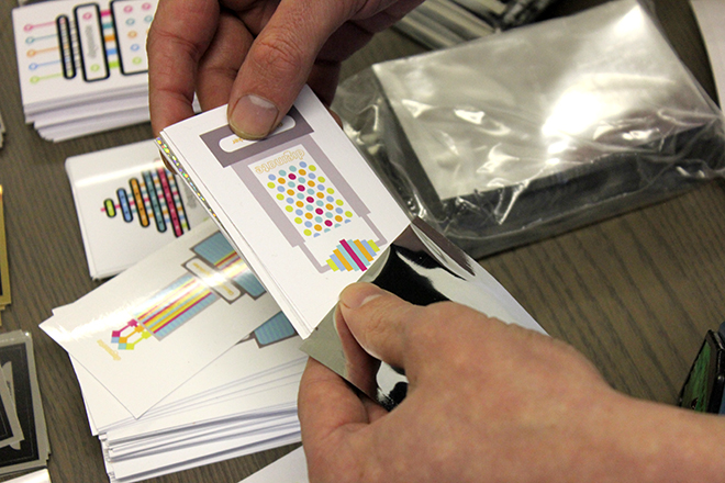 inserting stickers in pouches