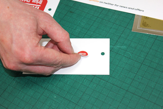 applying size stickers to clothing tags