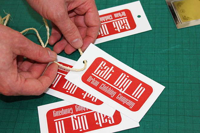 adding string to vinyl sticker tags