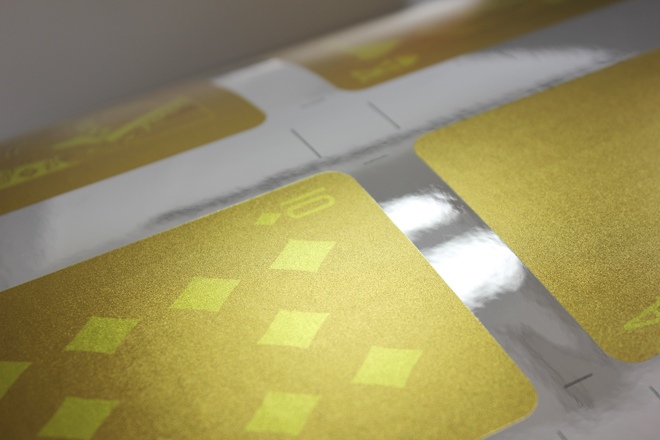 gold play cards on sheet